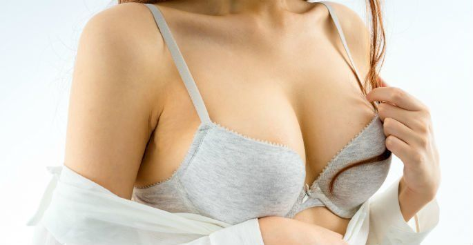 Woman wearing a white bra